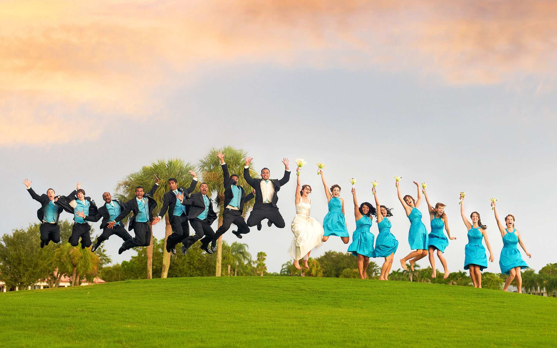 Large Bridal Party Jumping High in the Air Together