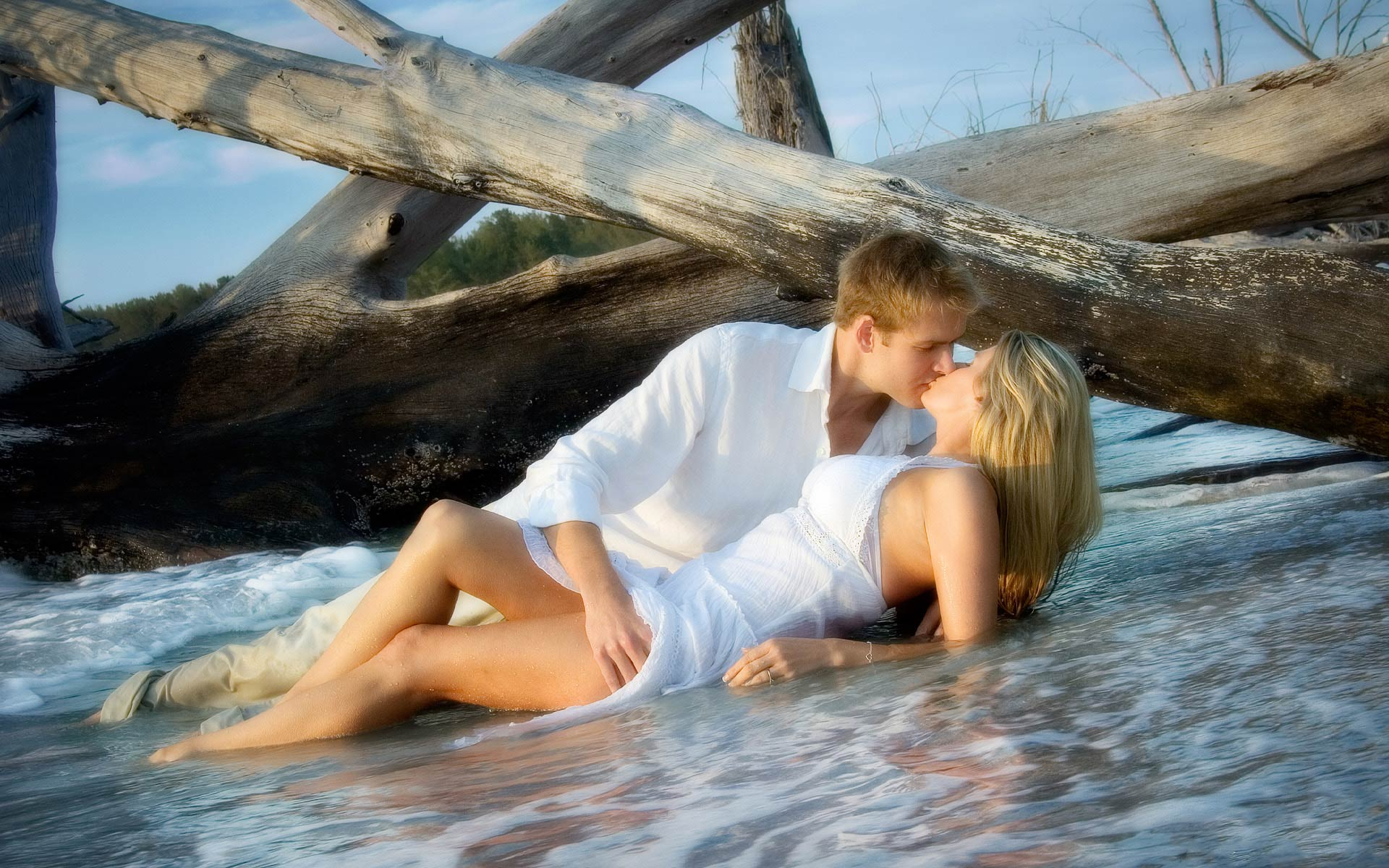 Romantic Engagement Session Over Breaking Waves