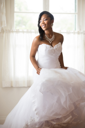 Pretty Bride Holding Wedding Gown