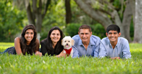 Family Picture Laying Grass Pet Dog