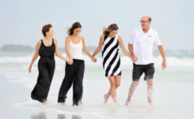 Portrait Family Walking Splashing Water Beach